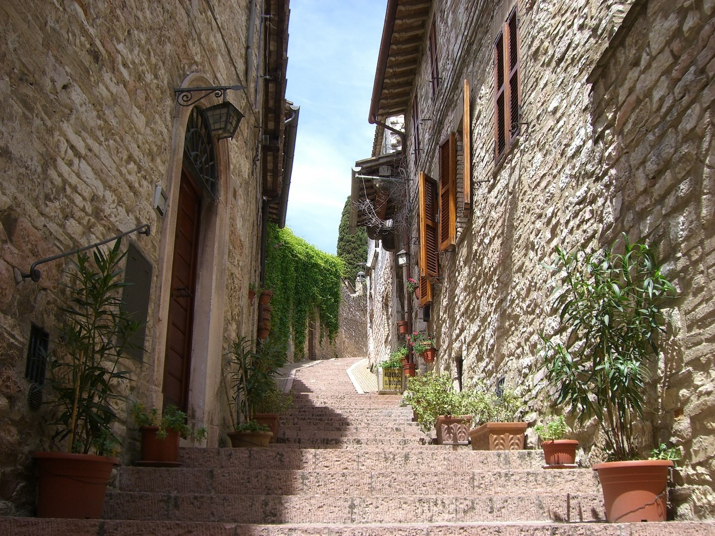 Stairs up a narrow pathway of an Italian village